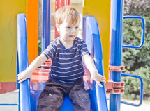 Small boy on a slide Royalty Free Stock Images