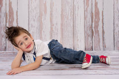 Small boy smiliing. And lying Stock Photos