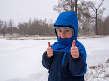 Small boy smiling. On a background of snow Royalty Free Stock Photo