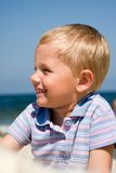 Small boy smiling on beach Royalty Free Stock Images