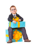 Small boy in spectecles with two big presents Stock Images