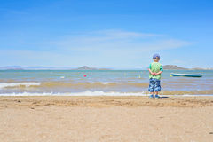 Small boy standing on the beach near Mar Menor Stock Photos