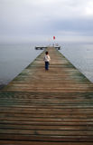 Small boy standing on a pier Royalty Free Stock Photos