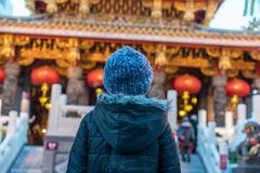 Small boy stares at buddhist temple. A small boy stares up at a colorful buddhist temple in Kyoto Japan Royalty Free Stock Photography