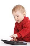 Small boy studies to count with the calculator Royalty Free Stock Images