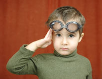 Small boy in swimming glasses plays Stock Image