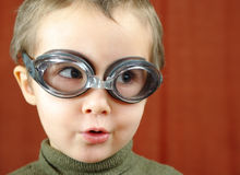 Small boy in swimming glasses plays Royalty Free Stock Photography