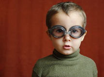 Small boy in swimming glasses plays Royalty Free Stock Images