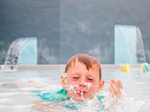 Small boy in swimming pool Royalty Free Stock Photography