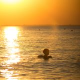 Small boy swimming in sea Royalty Free Stock Images
