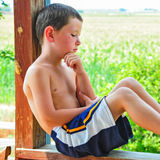 Small Boy Taking a Break on a Hot Summer Day Royalty Free Stock Photography