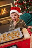 Small boy tasting christmas cake Royalty Free Stock Images