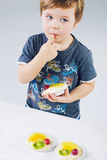 Small boy tasting the fruit cake Royalty Free Stock Images