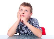 Small boy thinking Stock Image