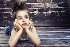 Small boy thinking Stock Photography