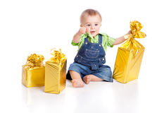 Small boy with three gifts in bright packaging Royalty Free Stock Photos