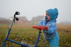 Small boy with three wheeler Royalty Free Stock Image