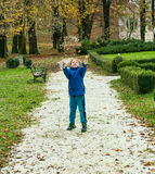 Small boy throwing pebbles Royalty Free Stock Images