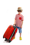 Small boy- tourist with a red suitcase Royalty Free Stock Images