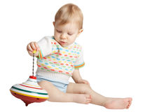 Small boy with a toy. On white Royalty Free Stock Images