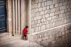 Small boy trying to hide royalty free stock photo
