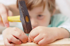 Small boy uses hammer Stock Image