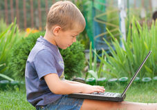 Small boy using notebook Stock Photo