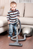 Small boy with vacuum cleaner Stock Photography