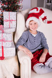 Small boy very excited about the gifts for christmas Royalty Free Stock Images