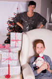 Small boy very excited about the gifts for christmas - mother in Stock Photos