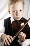 Small boy with a violin Stock Photo