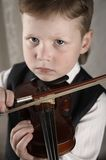Small boy with a violin royalty free stock image