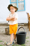 Small boy waiting with a bucket Stock Photo