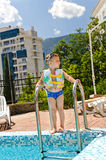 Small boy waiting to go swimming in the pool. Small boy waiting to go swimming pool standing at the top of the steps with his googlies and buoyancy jacket ready Royalty Free Stock Image
