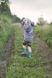 Small boy walking on the forest path Royalty Free Stock Image