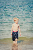Small boy walking in the sea Royalty Free Stock Images