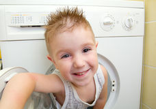 Small boy from washer Royalty Free Stock Photography