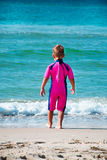 Small boy wearing diving suit going in sea Stock Image