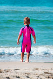 Small boy wearing diving suit going in sea Stock Photos