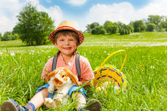 Small boy wearing hat and hugging rabbit Royalty Free Stock Photo