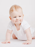 Small boy on white surface Royalty Free Stock Photography