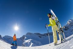 Small boy with woman in mask holding ski and poles Stock Photos