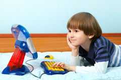 Small boy work at the computer. The preschool child work at the toy computer Royalty Free Stock Image