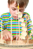 Small boy work with zeal on artificial ship Royalty Free Stock Images