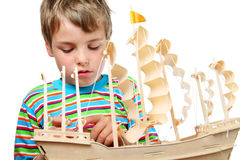 Small boy work with zeal on artificial ship Royalty Free Stock Photos