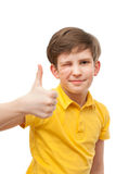 Small boy in yellow t-shirt shows a gesture of Fine Royalty Free Stock Image