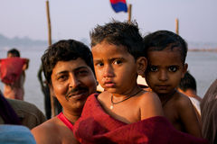 Small boys and father after bathe in the Ganges Royalty Free Stock Images