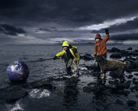Small boys saving a globe Stock Image