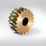 Small brass gear macro Stock Photography