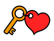 Small brass key with a red heart-shaped tag Royalty Free Stock Image